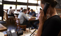 gallery/young-woman-taking-a-reservation-by-phone-at-a-res-PNRMW7V